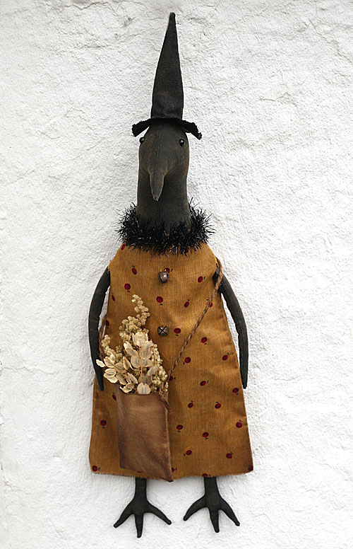 primitive crow doll in a witch hat