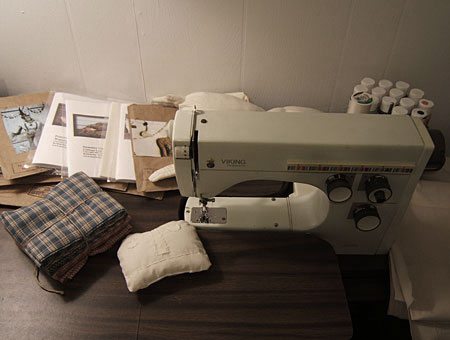 my vintage sewing machine surrounded by primitive patterns and dolls