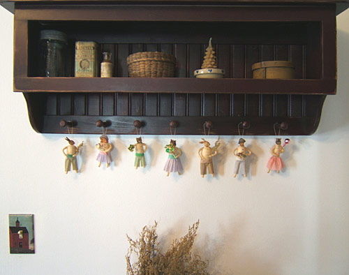 spun cotton ornaments on a peg rack