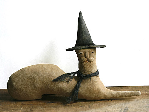 primitive cat doll in a witch hat
