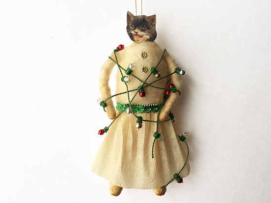 spun cotton cat ornament tangled in Christmas lights